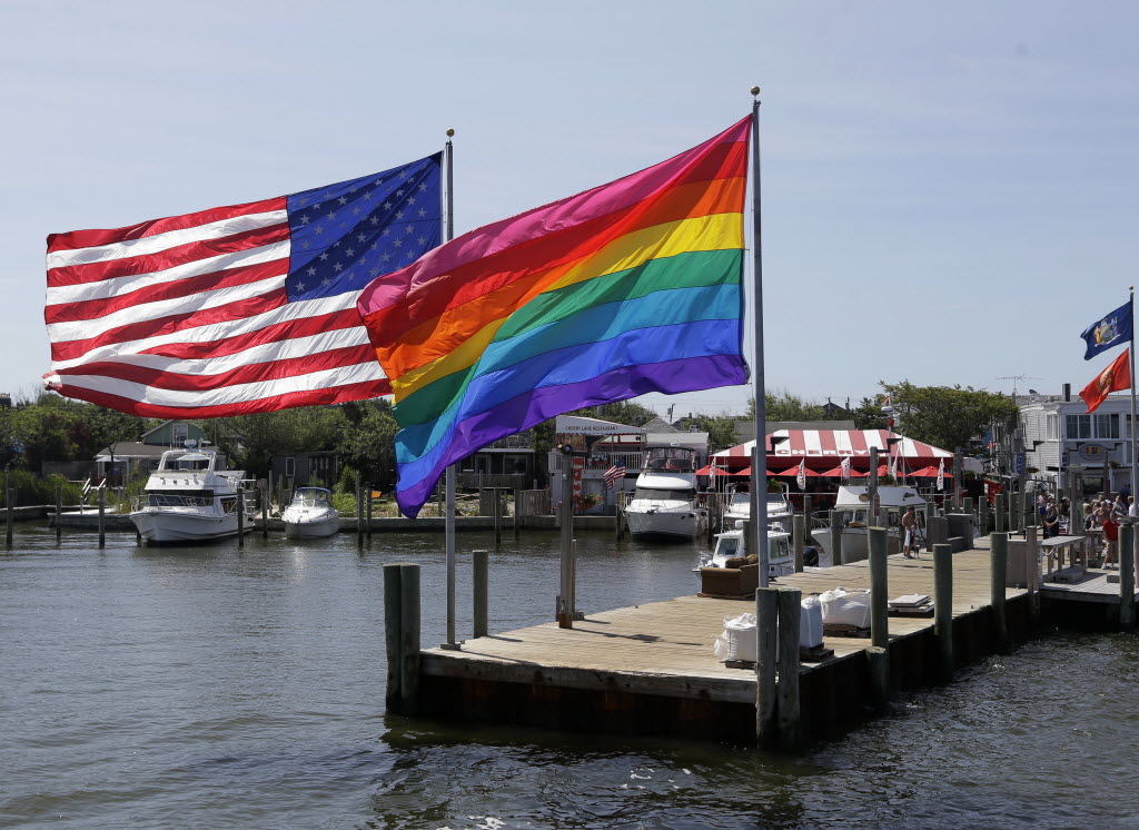 1171999 bytes; 3956 x 2884; In this June 23, 2013 photo, an American flag and a LGBT Rainbow flag are displayed on the ferry doc