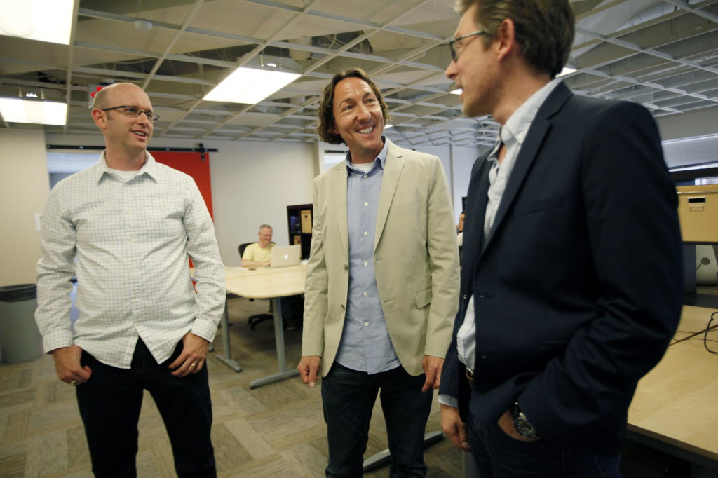 CEO David Lancashire of Projekt 202, center, speaks to general manager Russ Bair, left, and director of user experience Jeremy Johnson during an employee meeting in 2014. (Ben Torres/Special Contributor)