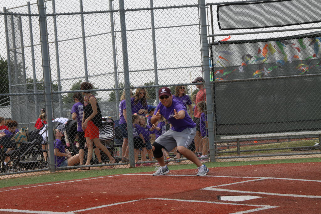 Loren Hsaio, Northwestern Mutual-Dallas managing director in Allen, gets everyone excited for a kickball tournament at the 2014 Northwestern Mutual Field Day. (Northwestern Mutual-Dallas)