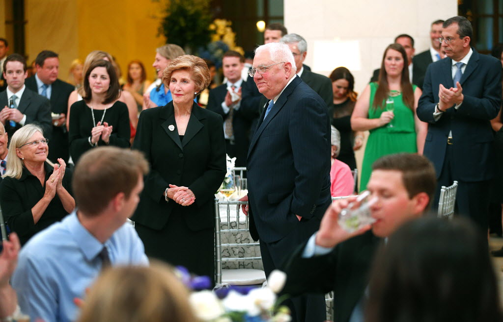 Merit Energy employees applaud founder and chairman of the board Bill Gayden and his wife Cynthia during the company's 25th anniversary party for employees and their spouses at the George W. Bush Presidential Library in 2014. (Tom Fox/The Dallas Morning News)