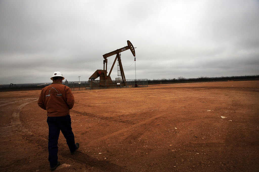 GARDEN CITY, TX - FEBRUARY 05: An oil well owned an operated by Apache Corporation in the Permian Basin are viewed on February 5, 2015 in Garden City, Texas. The well produces about 55-70 barrels of oil per day.