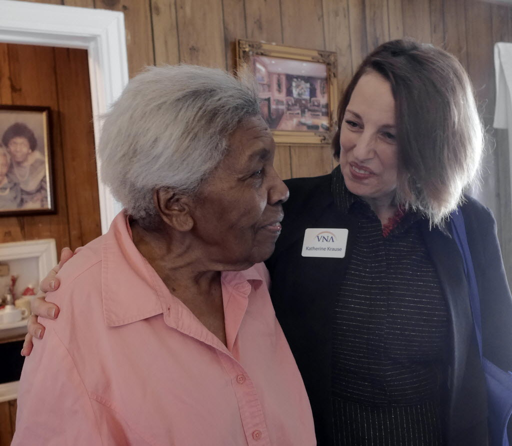Annie Mae Adams, left, visited with VNA president and CEO Katherine Krause as she delivered Meals and Wheels to clients with Dallas Fire-Rescue Chief Louie Bright in March. (Ron Baselice/The Dallas Morning News)