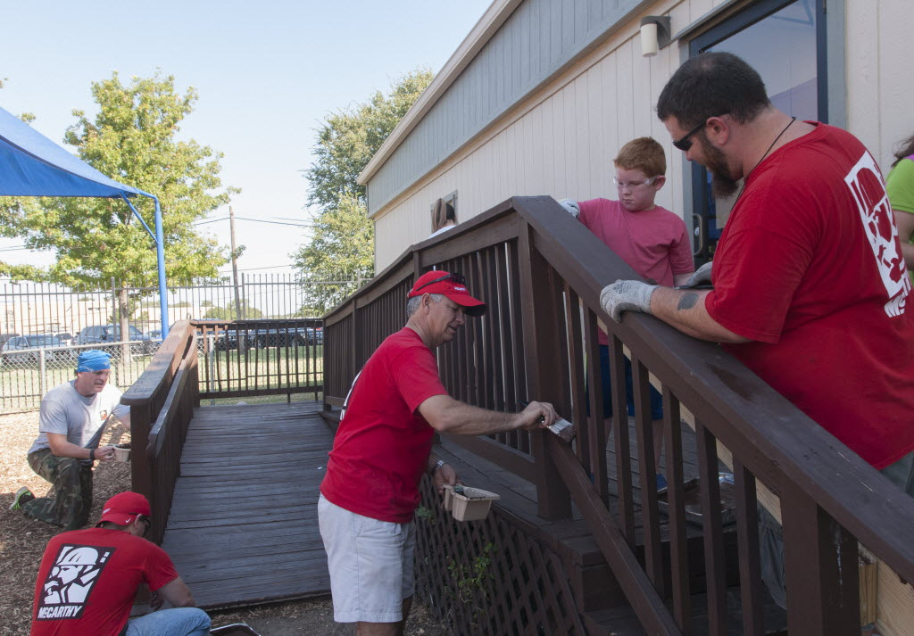 From left: Mark McElroy, Ryan Moret, Charlie Buescher, Marshall Clark, 8, his father Mark McElroy, and other employees of McCarthy worked on Mi Escuelita Preschool St. Matthews' campus in August. (Rex C. Curry/Special Contributor)