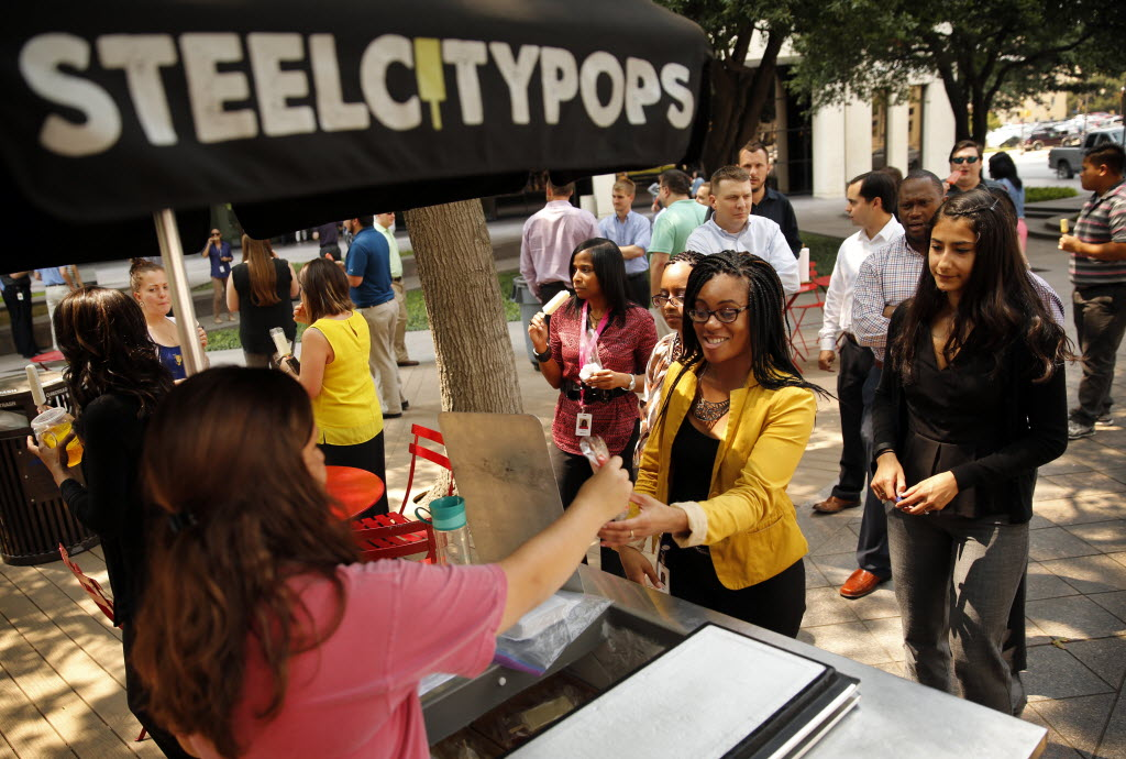 GM Financial employees are treated to Steel City Pops ice cream at Burnett Park in downtown Fort Worth as they kick off the company's United Way campaign. (Tom Fox/The Dallas Morning News)