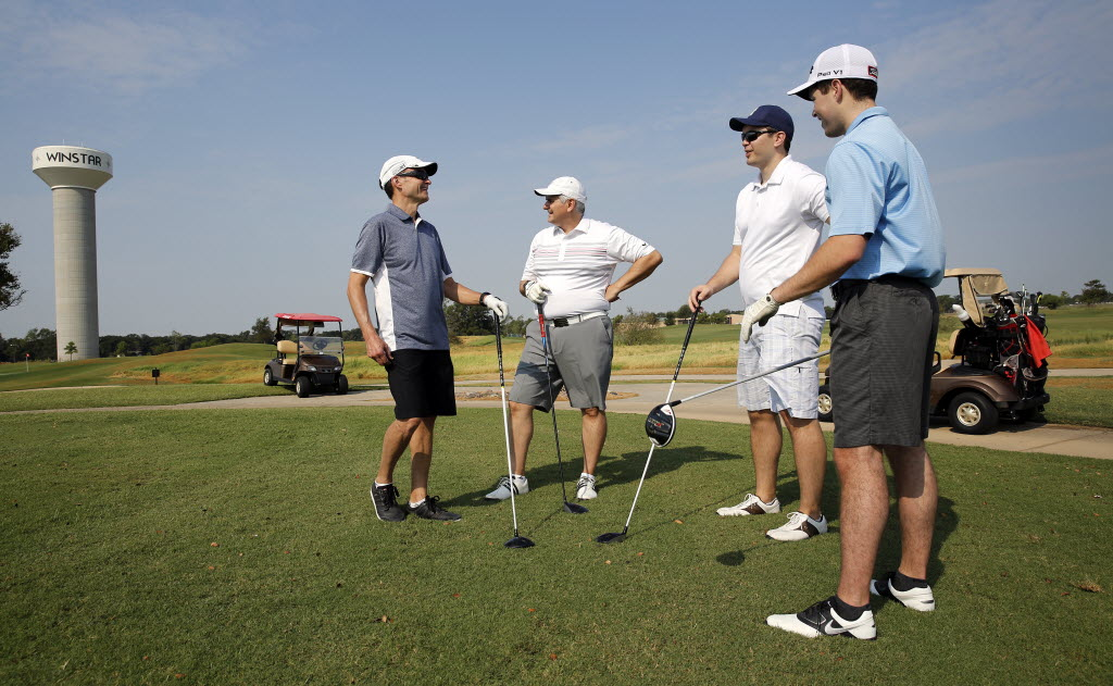 Felcor Lodging Trust employees (from left) Erik Nylen, Mike DeNicola, Chris Eckstein and Alex Smalanskas prepare to tee off during a round of golf at the WinStar World Casino and Resort in Thackerville, Okla. The company treated its employees to a couple of days of resort living. (Tom Fox/The Dallas Morning News)