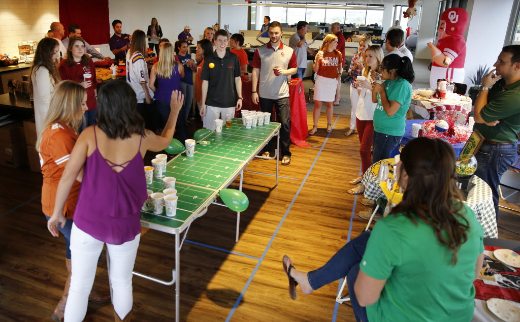 Centro employees had an office tailgate party to kick off the college football season. The very competitive college alums outdid themselves as they decorated with their school's colors. (Tom Fox/The Dallas Morning News)