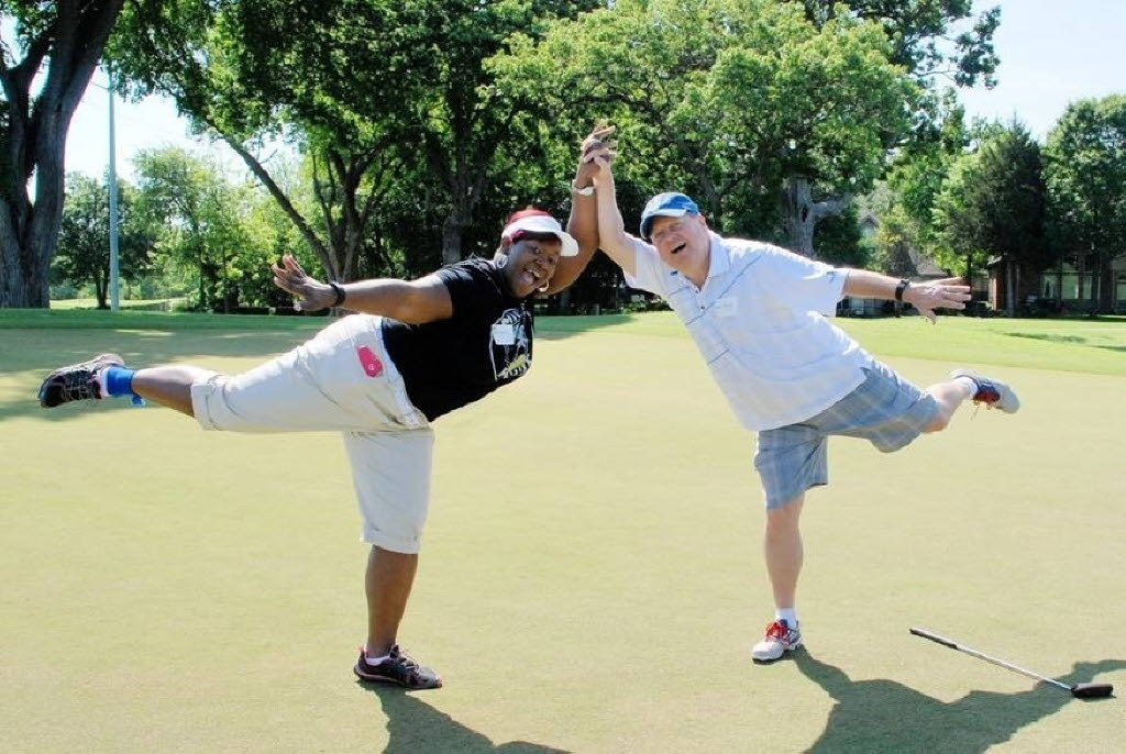 Minnie Kelley and David West clown around at a Group & Pension Administrators golf outing in May at Firewheel Golf Course. (Group & Pension Administrators)