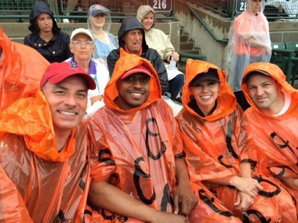 The Fenway Group management team enjoyed the baseball game, even in the rain.   (Fenway Group)