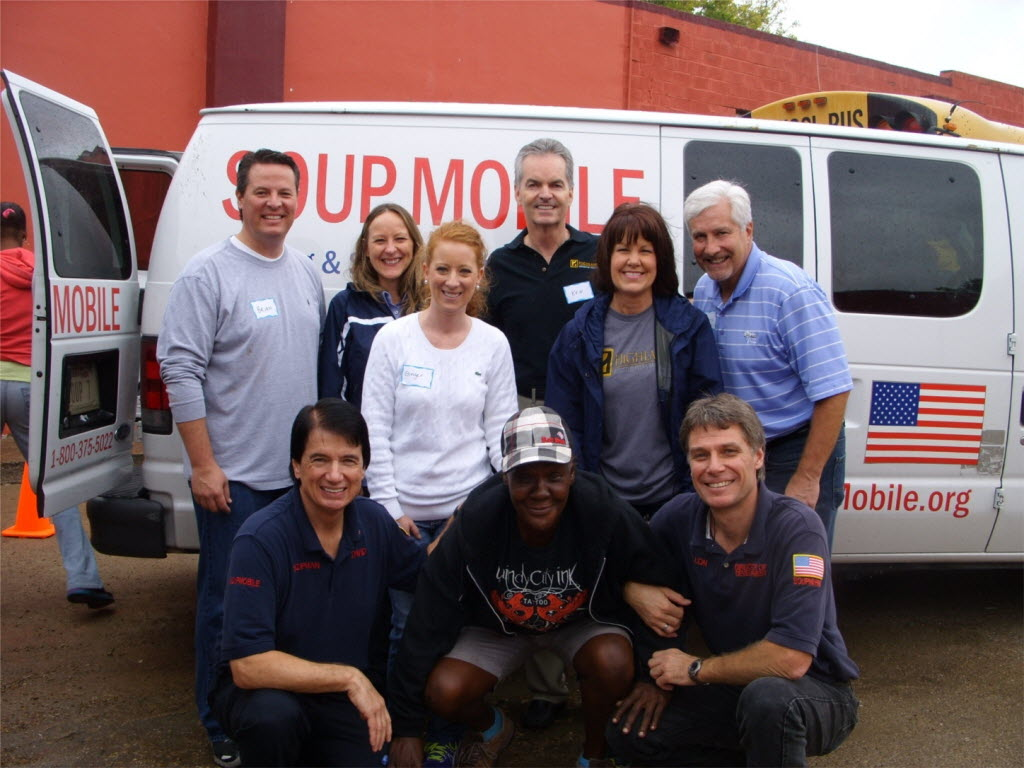 Highlands Residential Mortgage employees volunteer at the SoupMobile to feed the homeless. (Highlands Residential)