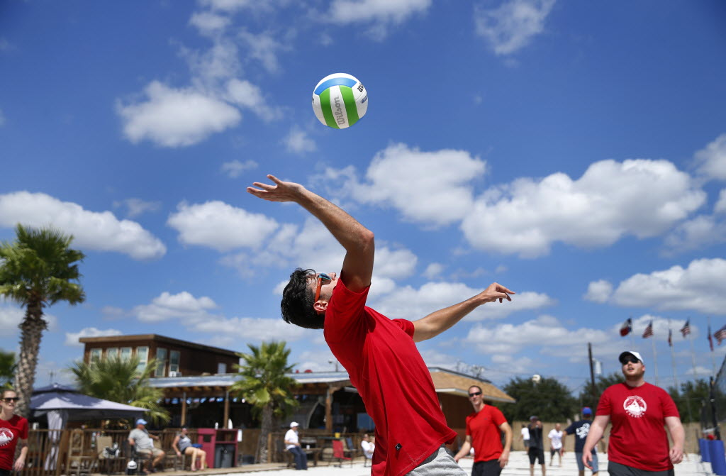 Credera consultant Kash Cummings returns a volley in the sand volleyball tournament at The Sandbar in Deep Ellum. Five teams from Credera participated in the event, which raised money for Junior Achievement of Dallas. (Tom Fox/The Dallas Morning News)