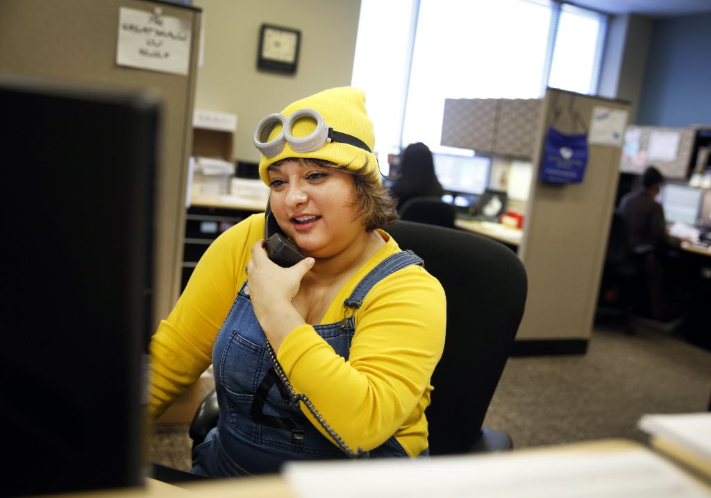 Cornea Associates of Texas patient coordinator team leader Lori Perez takes a call dressed as a minion from Despicable Me. She and her fellow team leaders dressed as movie characters and cooked breakfast for employees as part of Employee Appreciation Week in September.  (Tom Fox/The Dallas Morning News)