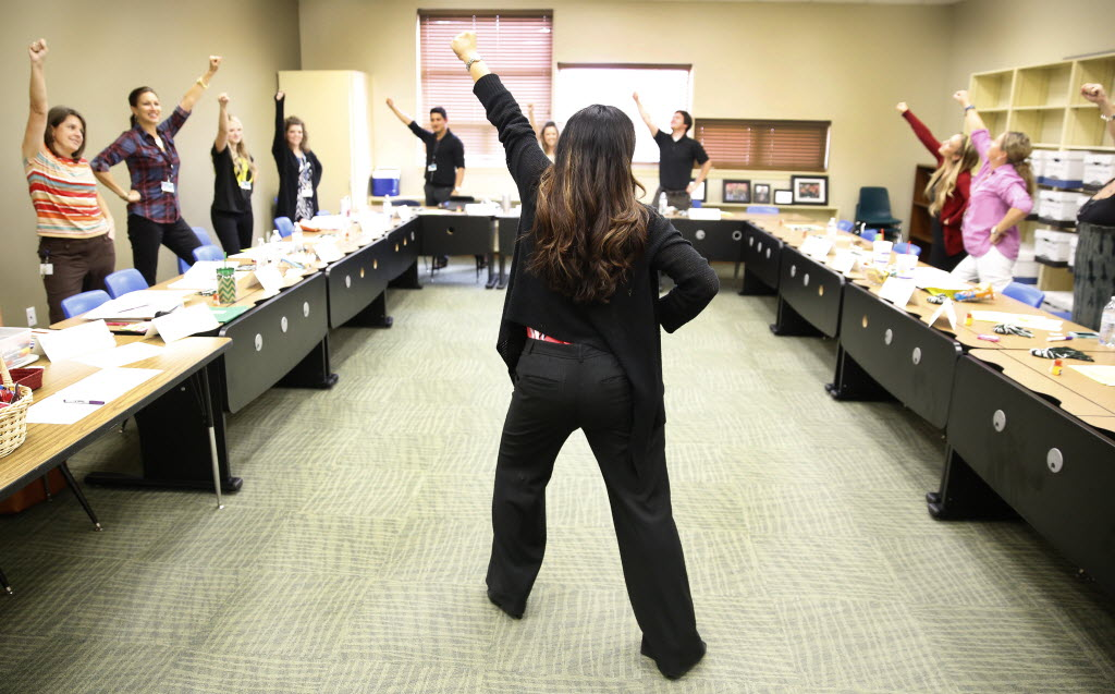 Prosper ISD director of human resources Bernie Gerace leads first-year teachers in stress relief power poses at Prosper's Central Administration Building. (Tom Fox/The Dallas Morning News)