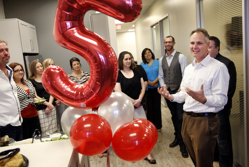 Service First Mortgage president and CEO Shawn Broussard (right) thanks his employees for their hard work as they celebrate the Plano office's fifth anniversary at the Shops at Legacy in Plano.(Tom Fox/The Dallas Morning News)