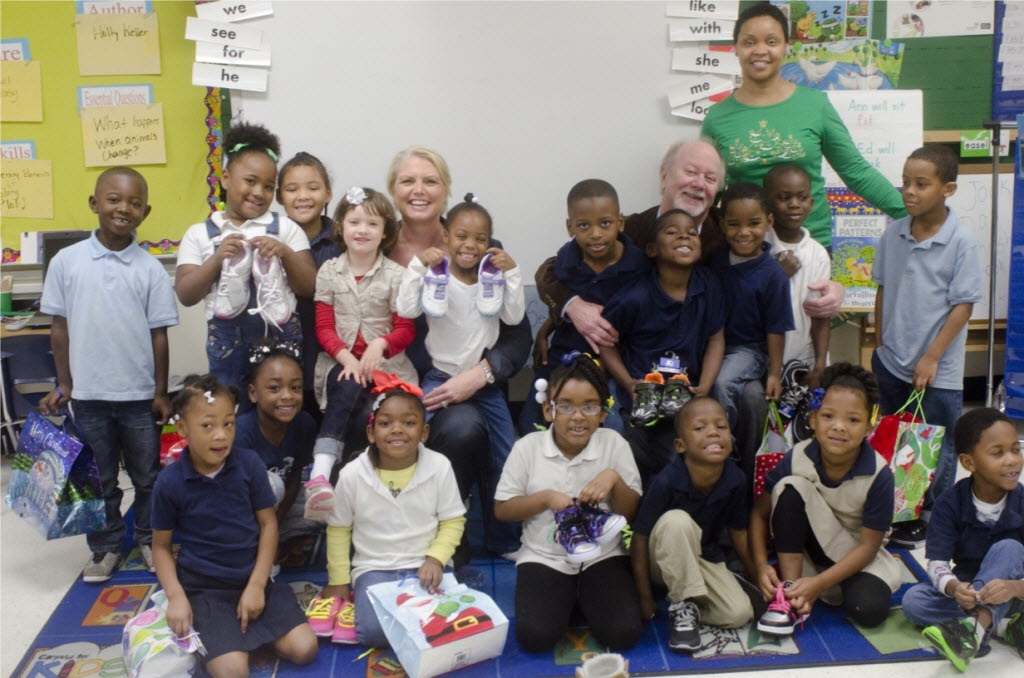 Amy Witherite and Brian Eberstein pose with Ms. Miller-Johnson's kindergarten class during the shoe drive at I.M. Terrell Elementary School in Fort Worth.   (Eberstein & Witherite)