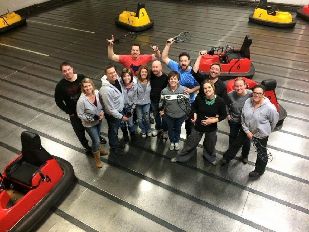 Halo Group Realty employees get ready to face off in bumper cars. (Halo Group)
