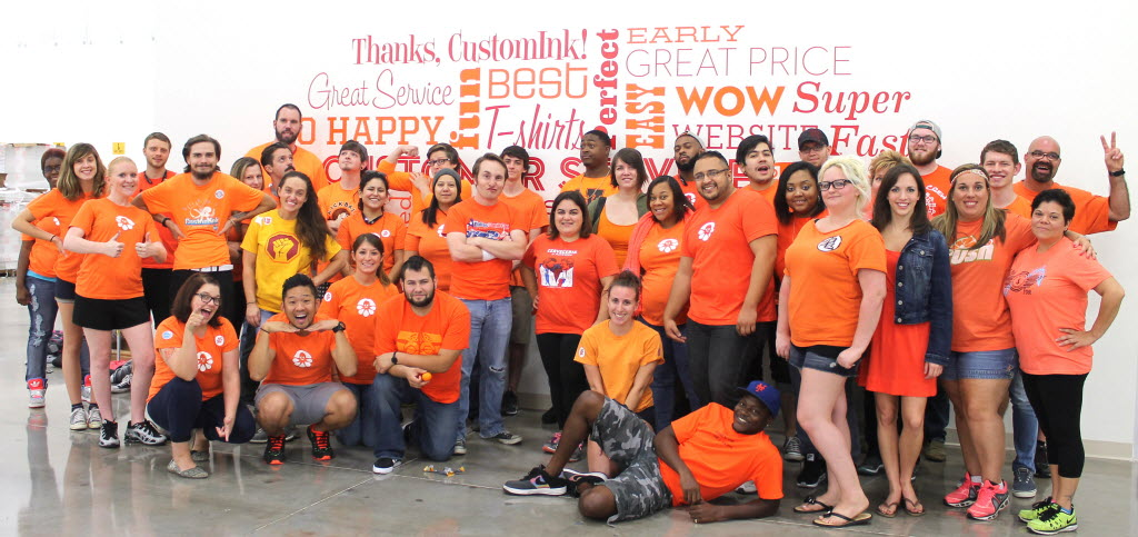 "CustomInk staffers at its Flower Mound facility wore orange in October on ""be kind to each other day."" It was the company's fifth year to participate in the anti-bullying campaign. (CustomInk)"
