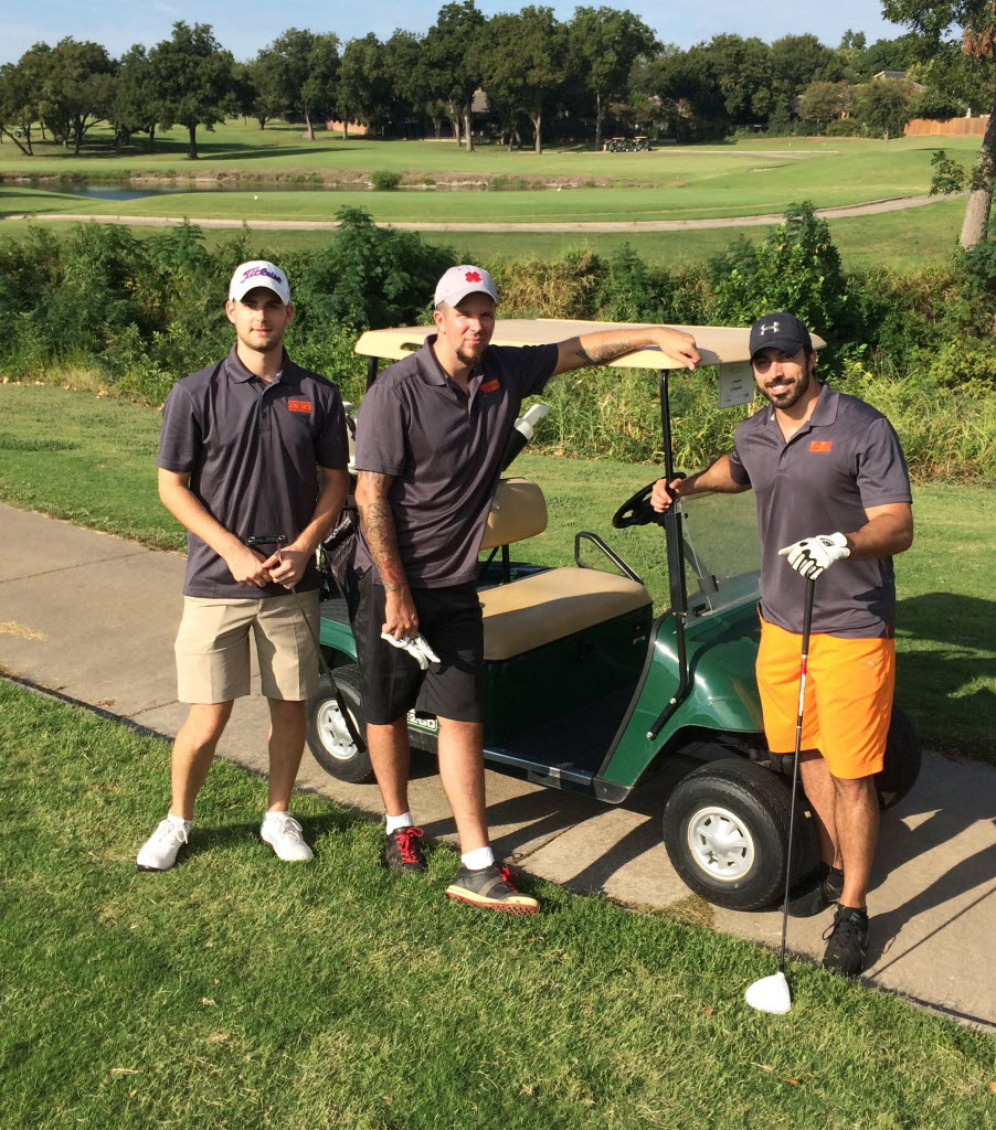 Armor employees enjoy some time on the links. (Armor)