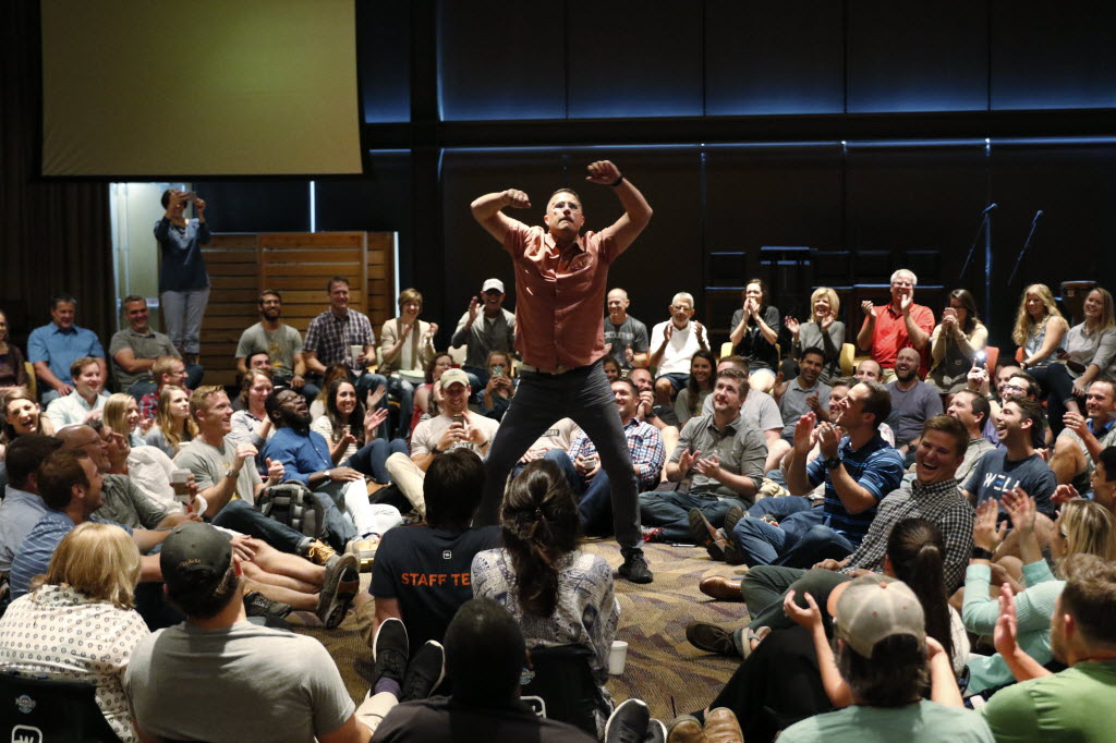 Jonathan Pokluda, center, leader of the Porch at Watermark Community Church, performs a dance before their once-a-week Tuesday staff prayer in Dallas on Aug. 16. (David Woo/The Dallas Morning News)