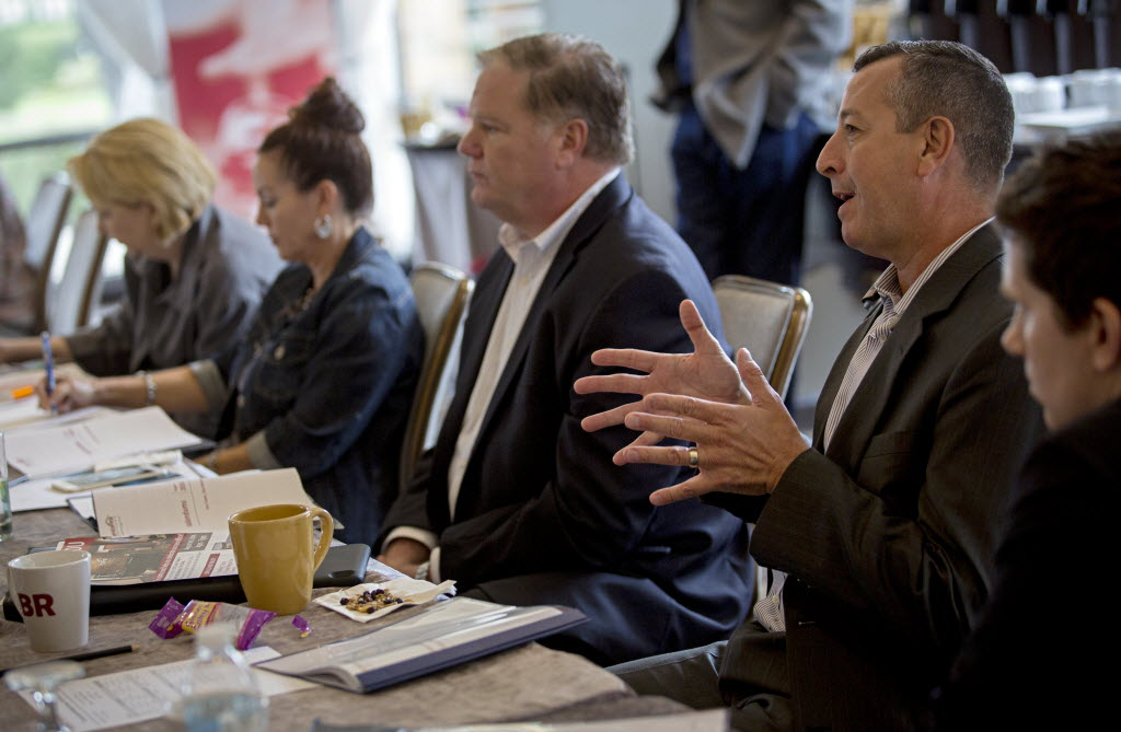 Chuck Barnes shares ideas during a meeting for branch managers and top performers with Service First Mortgage at the Four Seasons Resort and Club in Las Colinas. (G.J. McCarthy/The Dallas Morning News)