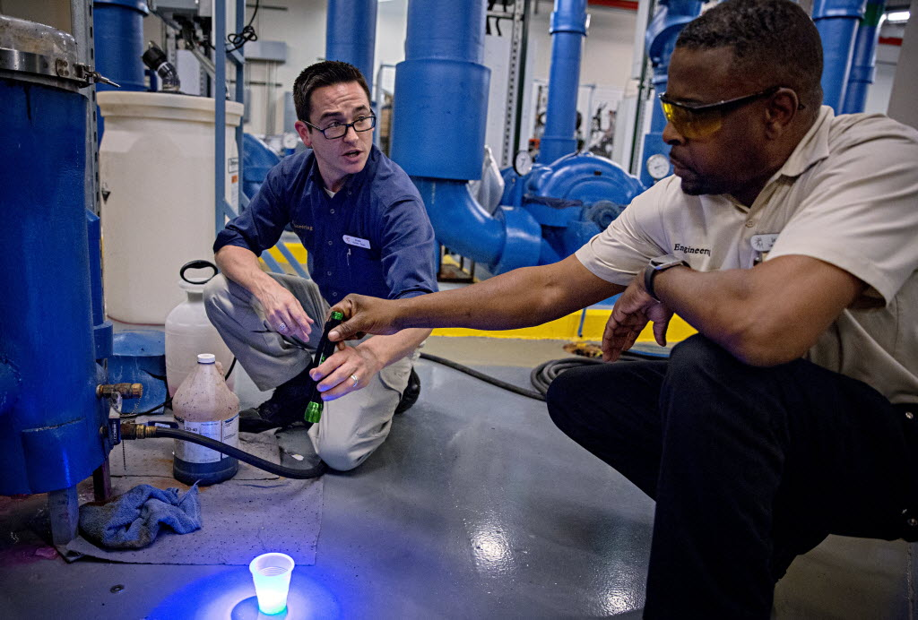 Blake Ramey (left), a plant operator at Gaylord Texan, and HVAC technician James Richard prepare to test a chill water system for leaks. (G.J. McCarthy/The Dallas Morning News)