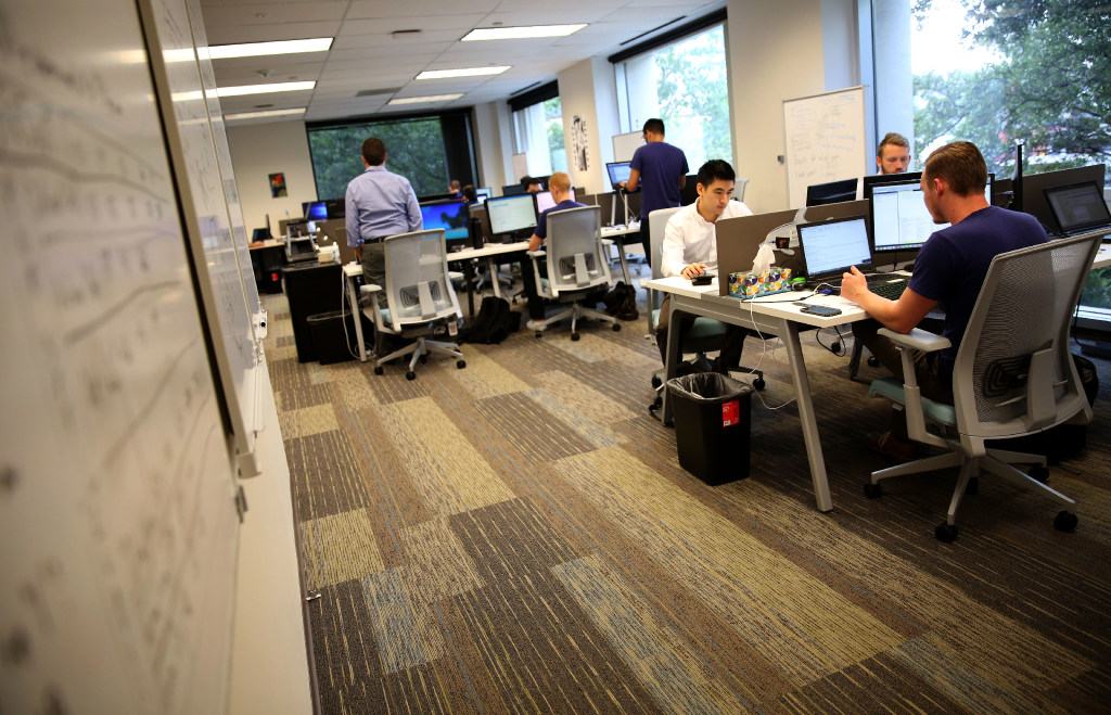 Project teams work at Pariveda Solutions headquarters in Dallas. (Rose Baca/The Dallas Morning News)