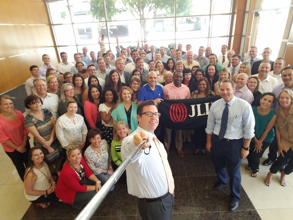 JLL's South Central Region market director David Carroll holds the selfie stick to get a photo of the Dallas staff. South Central Region president Jeff Staubach is in the blue shirt to the right.  (JLL)