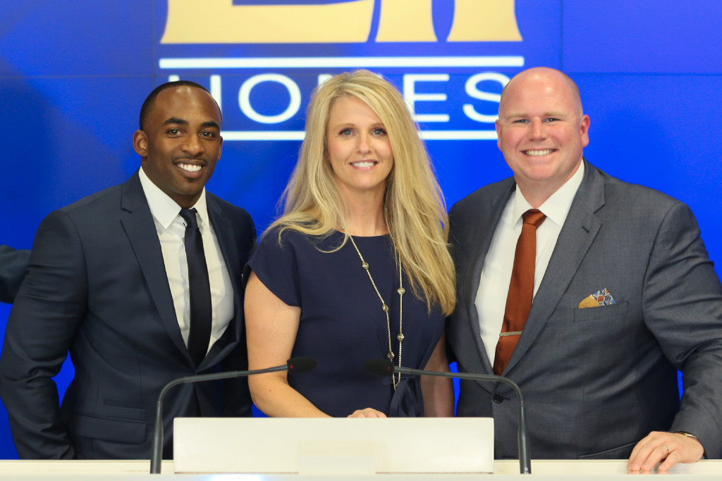 LGI Homes employees visiting the Nasdaq in New York last June were Marcus Johns, new home sales consultant, Stacy Conley, vice president of sales, and Lucas Lansman, vice president of operations. (Christopher Galluzzo)