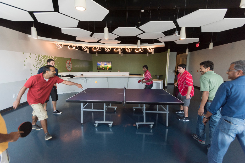 USAA workers play pingpong in the energize room at the insurance company's office building in Plano. (Rex C. Curry/Special Contributor)