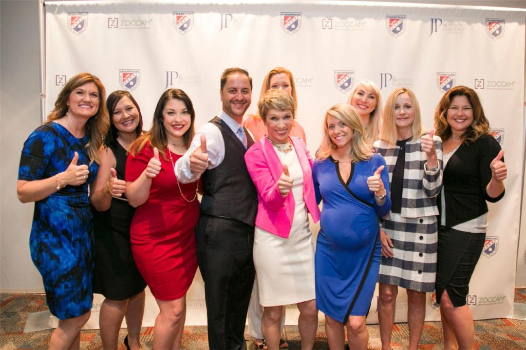 JP & Associates workers pose with Shark Tank's Barbara Corcoran. (JP & Associates)