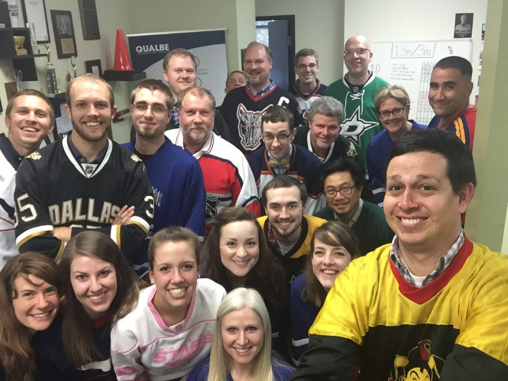 Qualbe Marketing Group staffers celebrated Canada Day by wearing hockey sweaters in its Fort Worth office and playing chair hockey in the employee game room. (Qualbe)