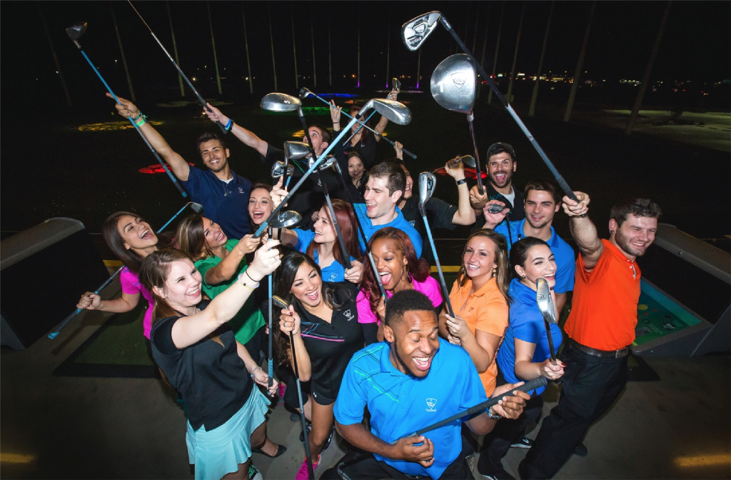 Topgolf employees from The Colony, Allen and Dallas have fun on a break during a photo shoot at Topgolf The Colony in fall 2015. Topgolf wokers are often the models in the company's advertisements. (Topgolf)