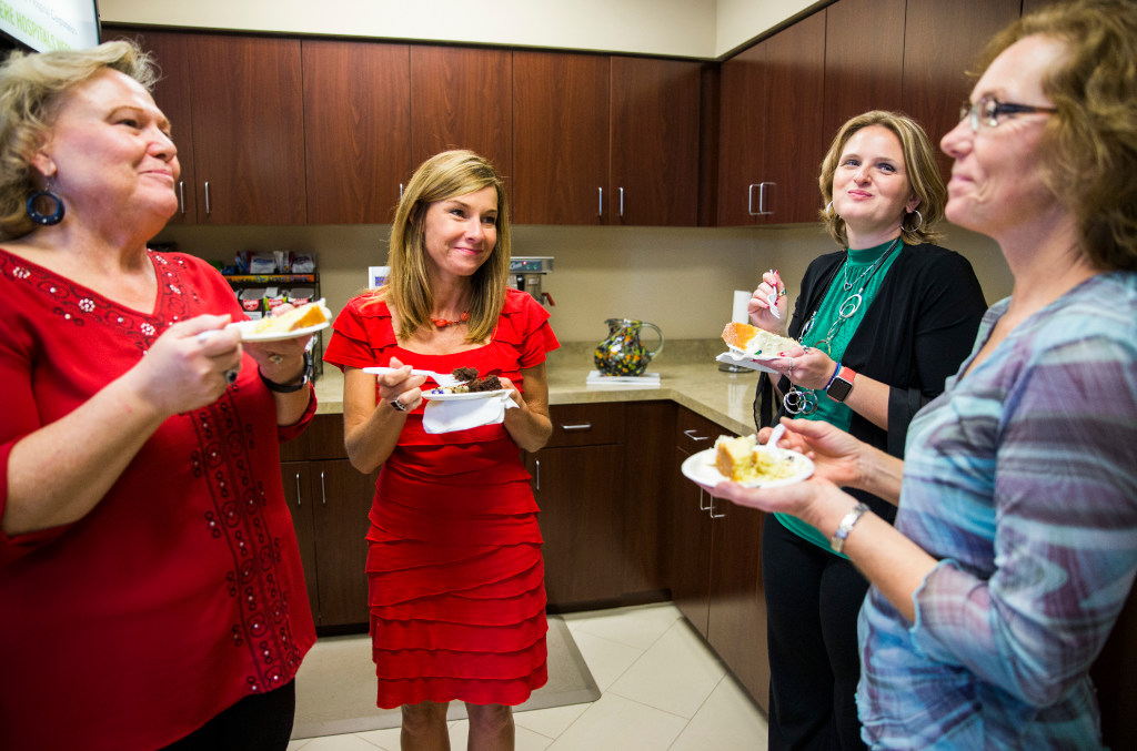 Community Hospital Corporation employees celebrate coworkers' birthdays. (Ashley Landis/The Dallas Morning News)