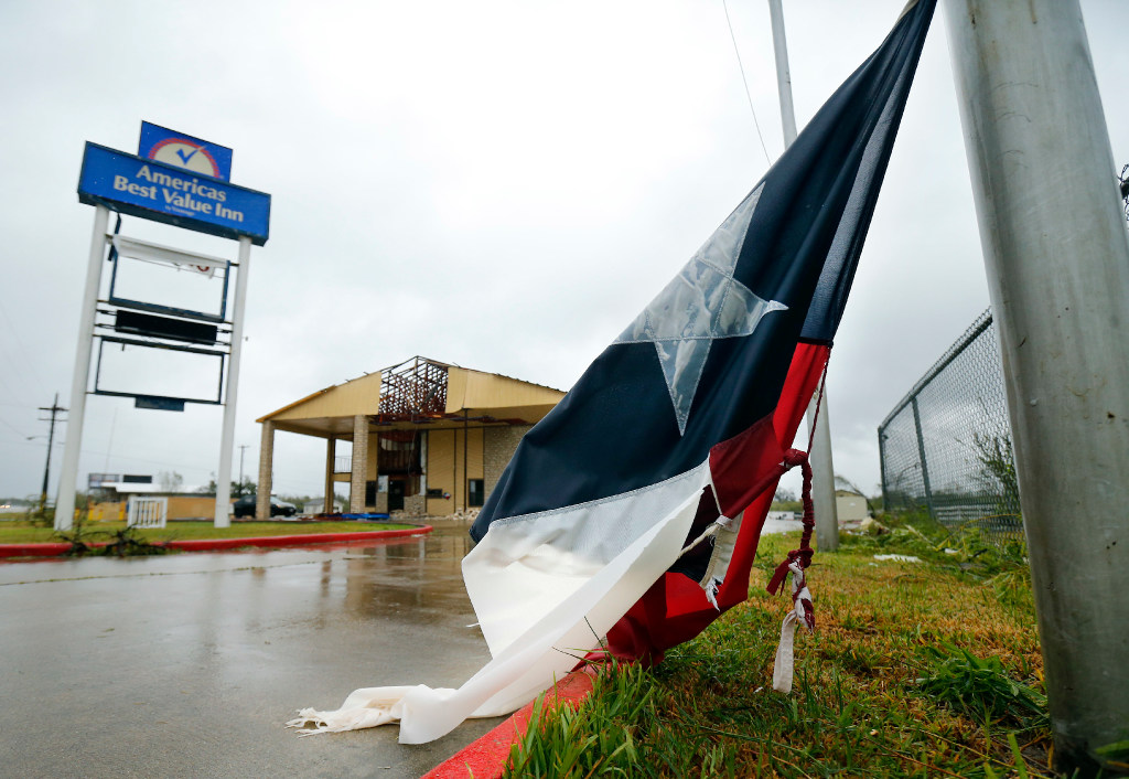 A tattered and wet Texas flag flaps in the wind outside the damaged America's Best Value Inn in Refugio, Texas, after Hurricane Harvey's category 4 eye wall hit August 26. The leisure and hospitality sector lost 21,300 in Texas in September as part of the Harvey fallout.